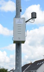 An air monitor attached to a pole