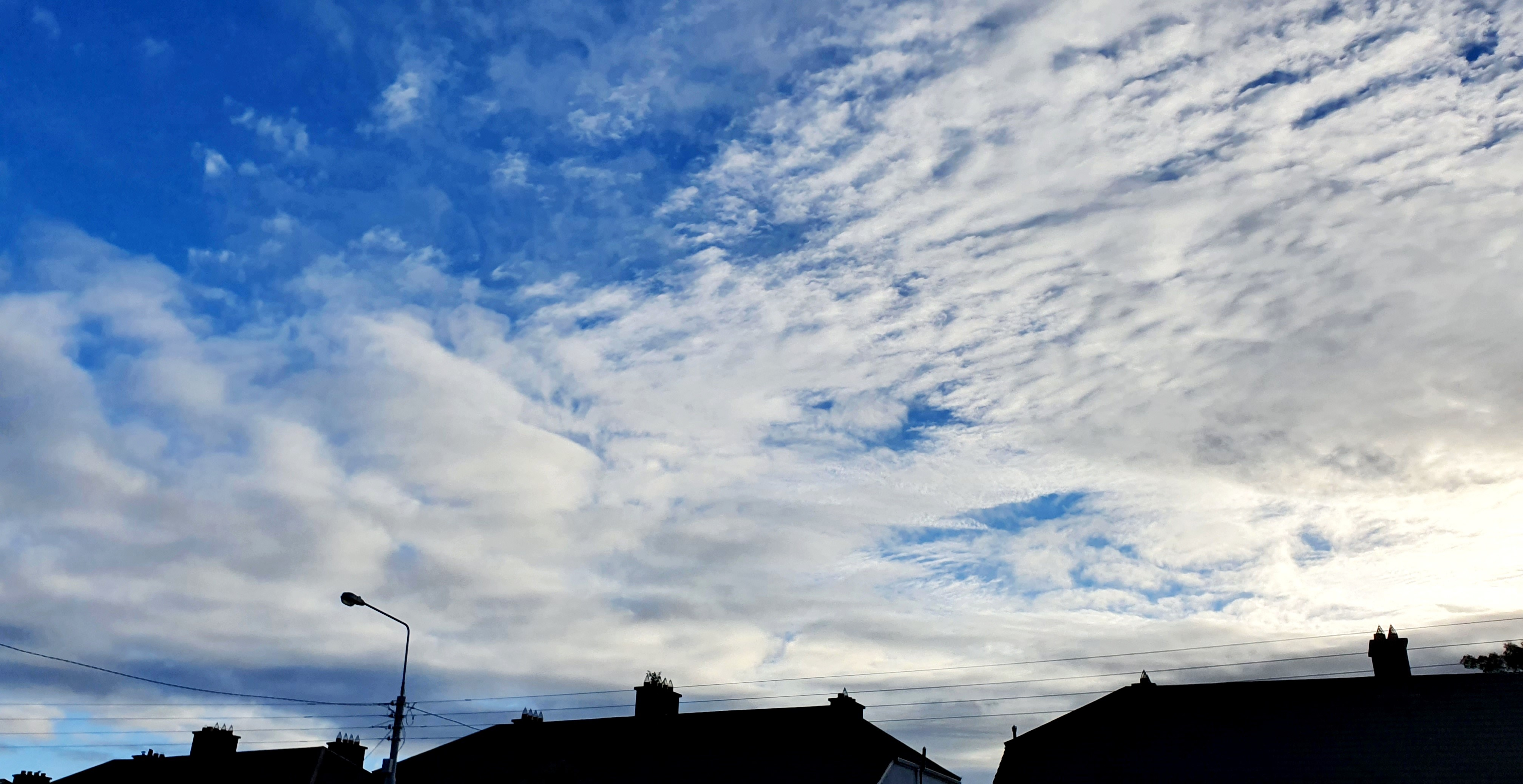 Clouds over house in a blue sky
