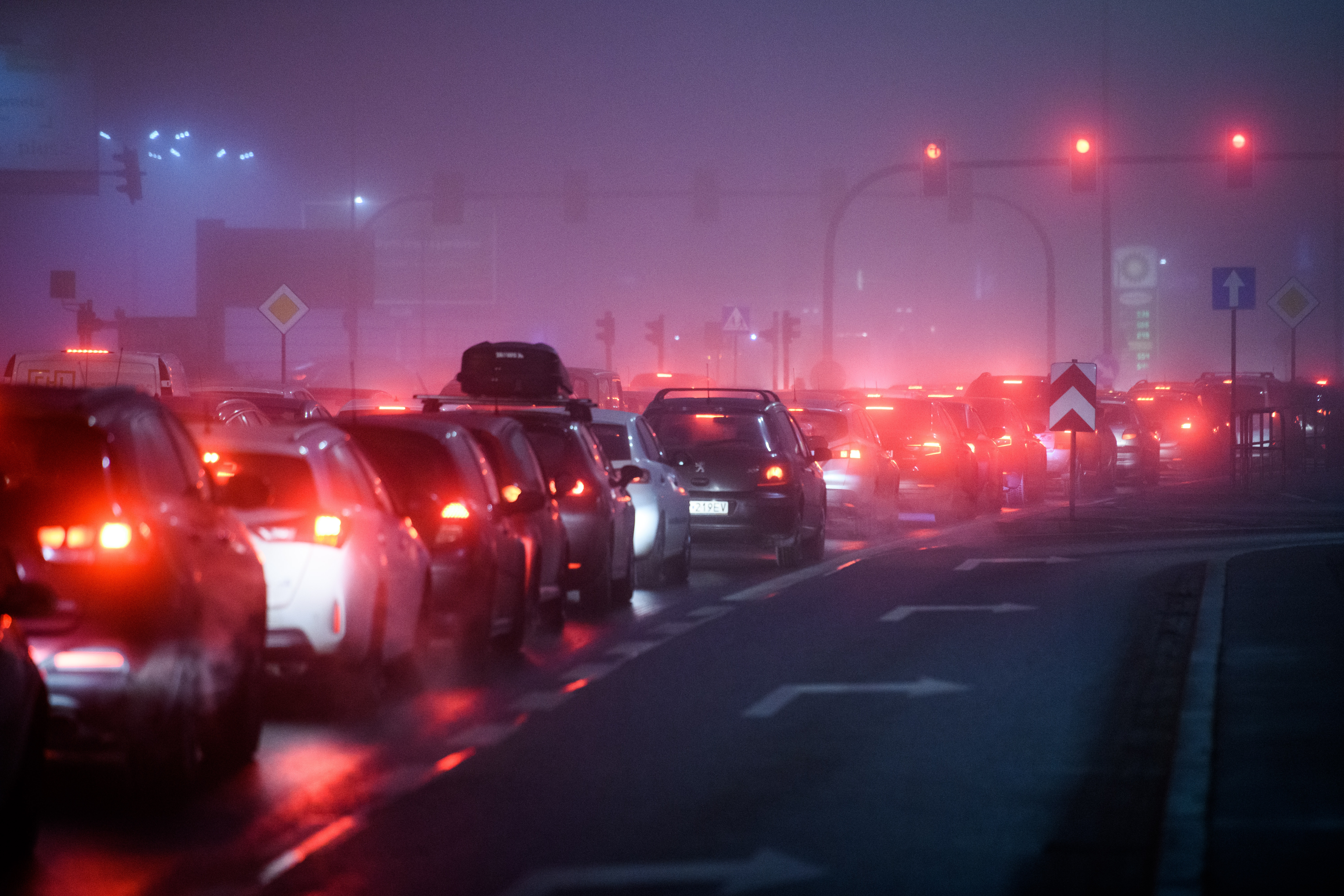 traffic jam at night with exhaust fumes
